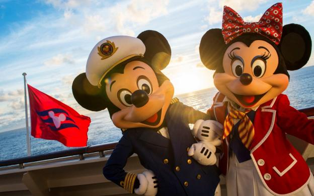 mickey mouse and minnie mouse on board a ship with a disney flag