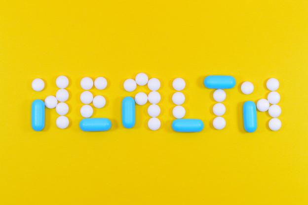 white and blue tablets spelling out the word HEALTH