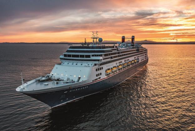 Borealis cruise ship at sea with sunset in the background